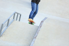 Skateboarding legs riding on a skateboard Royalty Free Stock Images