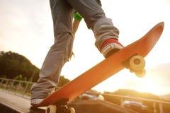 Skateboarding legs at skatepark Stock Photos