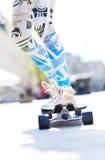 Skateboarding. Legs in sneakers on a skateboard Stock Photo