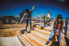 Skateboarding boys Stock Images
