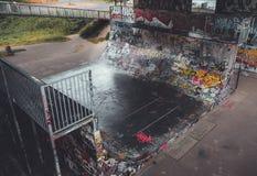 Skateboarding playground painted graffiti under the bridge. stock image