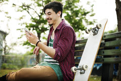 Skateboarding Sitting Relaxation Park Holiday Concept.  Stock Image