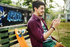 Skateboarding Sitting Relaxation Park Holiday Concept.  Royalty Free Stock Images