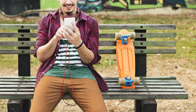 Skateboarding Sitting Relaxation Park Holiday Concept Stock Photos