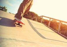 Skateboarding at skatepark Stock Image