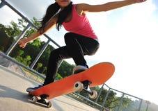 Skateboarding at skatepark Stock Photos