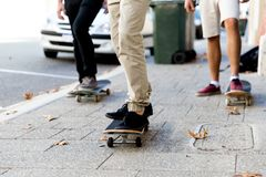 Skateboarding at the street. Skateboarding with friends at the street in summer Royalty Free Stock Images