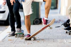 Skateboarding at the street. Skateboarding with friends at the street in summer Stock Photo