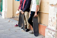 Skateboarding at the street. Skateboarding with friends at the street in summer Stock Image