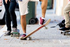 Skateboarding at the street. Skateboarding with friends at the street in summer Stock Photography