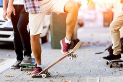 Skateboarding at the street. Skateboarding with friends at the street in summer Royalty Free Stock Photography