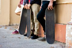 Skateboarding at the street. Skateboarding with friends at the street in summer Royalty Free Stock Image