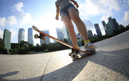Skateboarding at sunrise city Stock Image