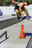 Skateboarding trick. Young man skateboarding, jumping off ramp over orange cone. Taken at Santa Barbara Skate park called Skaters Point August 8/24/14 Royalty Free Stock Images