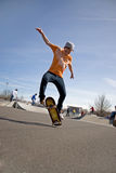 Skateboarding Tricks. A young skateboarder doing a stunt in a skate park royalty free stock images
