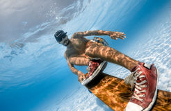 Skateboarding underwater Stock Photography