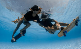 Skateboarding underwater Royalty Free Stock Photo