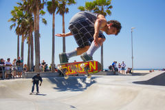 Skateboarding at Venice Beach. VENICE, CALIFORNIA - April 20, 2017: Crowd watching skateboarder Brian Waters doing tricks  at Venice Skate Park in Venice Beach Royalty Free Stock Photography