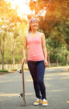 Skateboarding woman Royalty Free Stock Image
