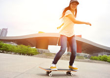 Skateboarding woman in the city Stock Photo
