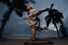 Skateboarding woman royalty free stock images
