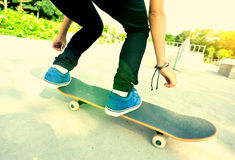 Skateboarding woman Stock Photo