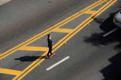 Skateboarding. A young man goes to work on skateboard in miami beach stock image