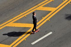Skateboarding. A young man goes to work on skateboard in miami beach royalty free stock photos