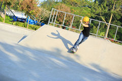 Skateboarding young woman riding on a skateboard Stock Images