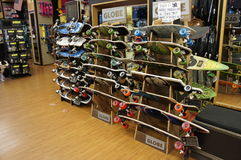 Skateboards on Sale. Displayed Skateboards are on sale inside of the board shop store Royalty Free Stock Photos
