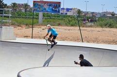 Skatepark滑行车特技 免版税库存图片
