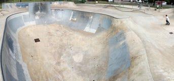 Skatepark. A skate park circular half pipe stock photo