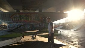 Skatepark with graffiti. Young man on rollerblades outdoor stock footage