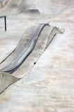 Skatepark grind rail. A curvy grind rail in a skate park stock photos