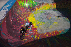 SKATEPARK_RIDER_1. A bike rider drops into a multicolor pit at a skate park in Halifax, Nova Scotia Royalty Free Stock Image