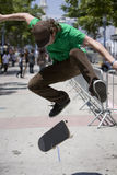 Skater 1. Vertical image of a skateboarder jumping / doing a trick Stock Images