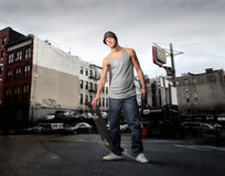 Skater. Boy with skateboard in a city street Royalty Free Stock Photo