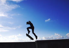 Skater. Run on the blue sky Stock Photography