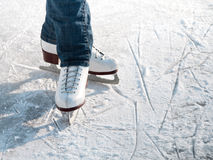 Skater. Legs of skater on winter ice rink in outdoors Royalty Free Stock Photos