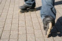 Skater. In-line skating in the sun Royalty Free Stock Image