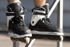 Skater in aggressive rollerblades in a skatepark Stock Photos
