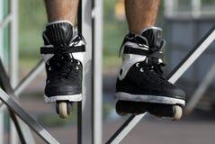 Skater in aggressive rollerblades in a skatepark Stock Images