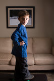 Skater boy. Young boy skate boarding in the house with dynamic lighting Royalty Free Stock Images