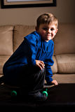 Skater boy. Young boy skate boarding in the house Stock Photography