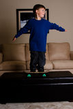 Skater boy. Young boy skate boarding in the house Royalty Free Stock Photo