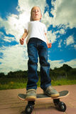 Skater boy child with his skateboard. Outdoor activity. Stock Photography