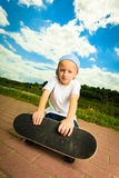 Skater boy child with his skateboard. Outdoor activity. Stock Image