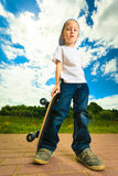 Skater boy child with his skateboard. Outdoor activity. Stock Images