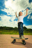 Skater boy child with his skateboard. Outdoor activity. Stock Photos