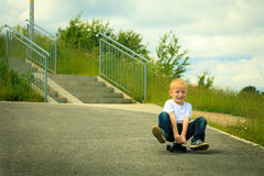 Skater boy child with his skateboard. Outdoor activity. Royalty Free Stock Photography